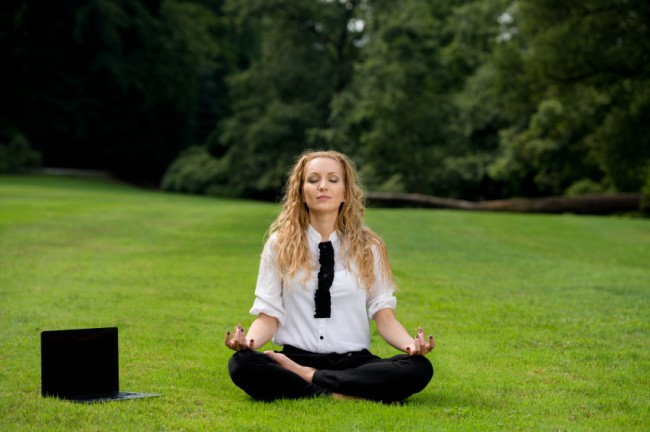 Professional Woman Meditates in a Field