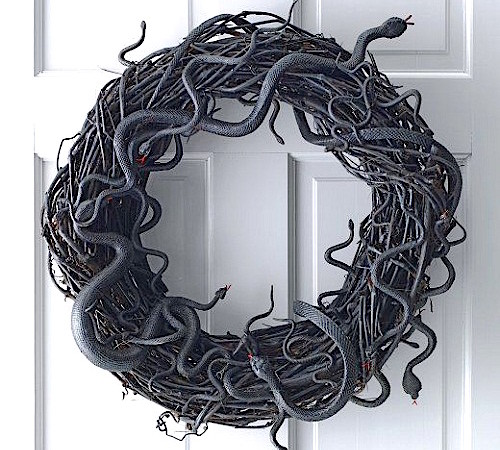 http://howtomakeaburlapwreath.com/make-snake-halloween-grapevine-wreath-video/
