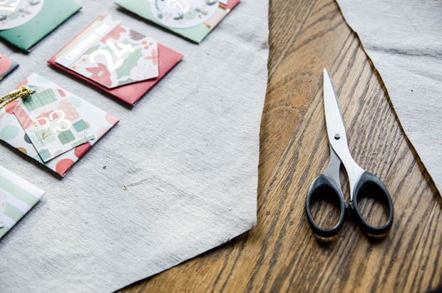 An activity-based advent calendar DIY from CreativeLive! http://blog.creativelive.com/diy-a-lovely-advent-calendar-with-my-minds-eye-christmas-on-market-street-supplies/