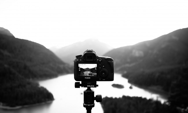 Black and white landscape photo with camera