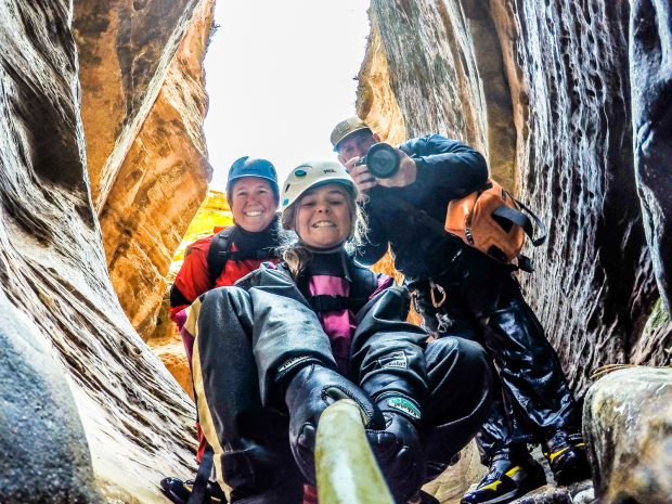 Kathy Holcombe and family in a cave