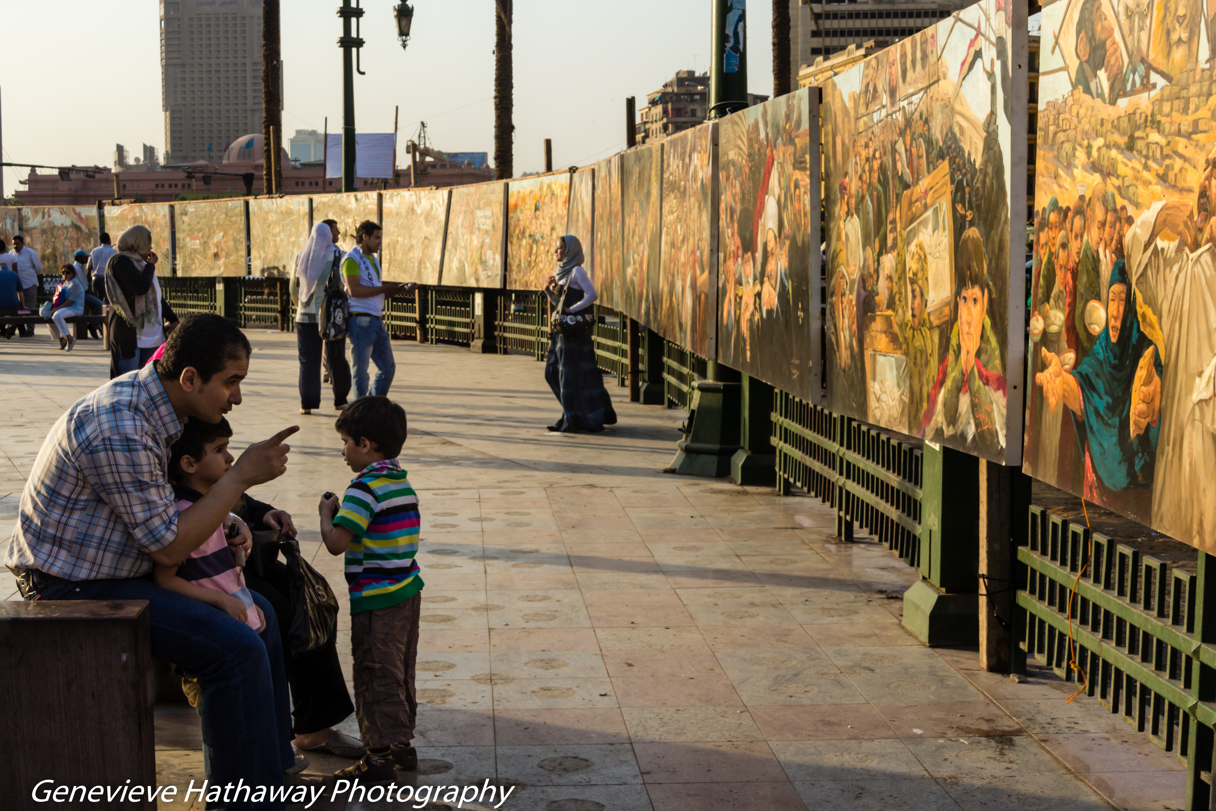 Egyptian families admire murals in public gallery