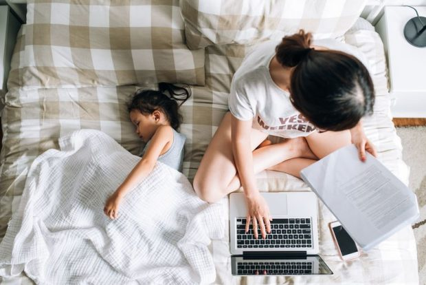 Work-from-home jobs are on the rise. Woman works at home with her daughter.